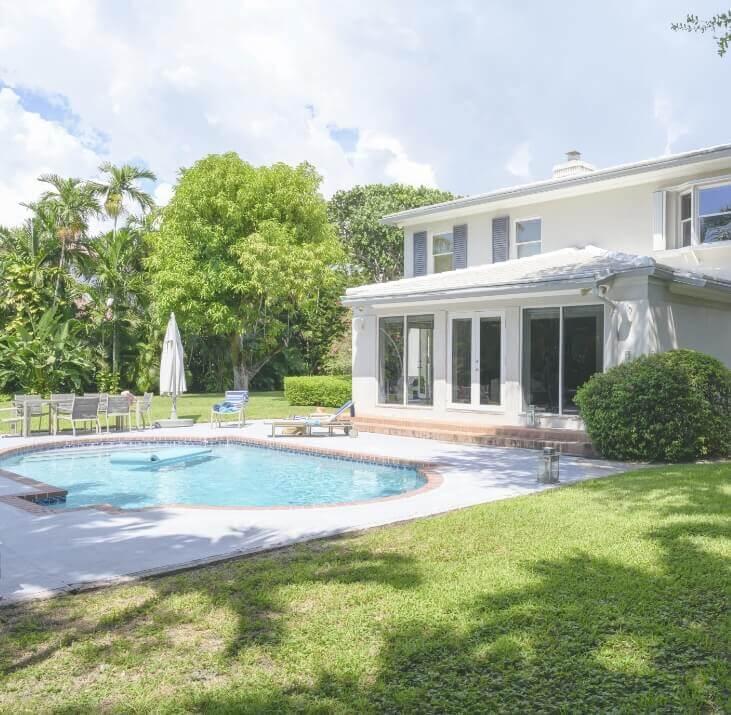 Inground pool next to house