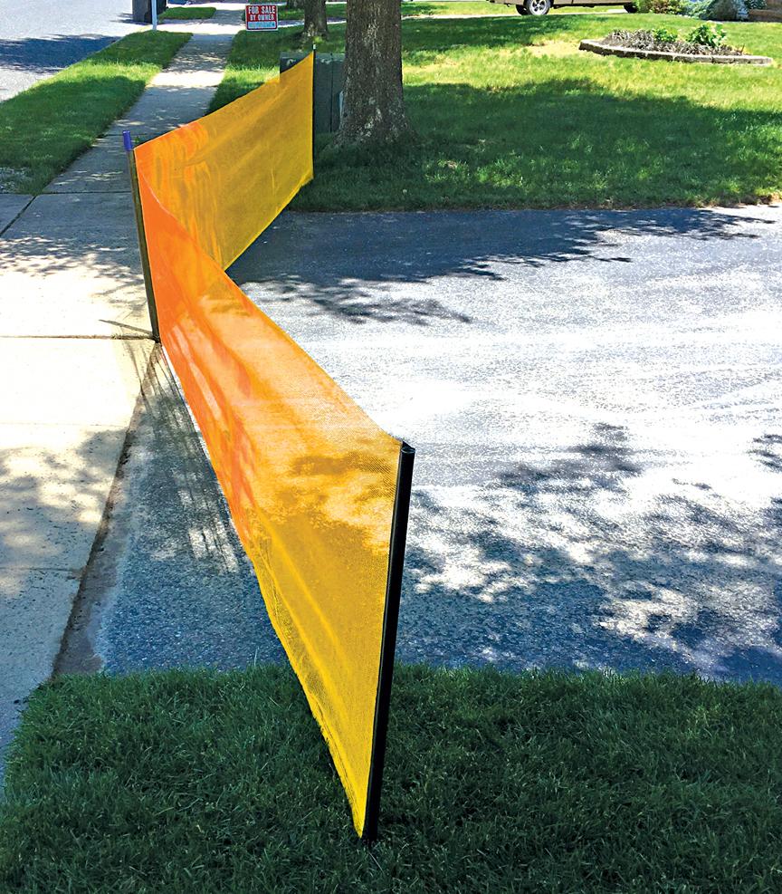 Orange driveway safety net on driveway