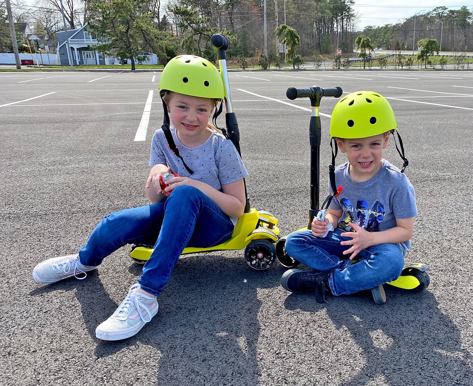 Two children sitting on BeeFree scooter