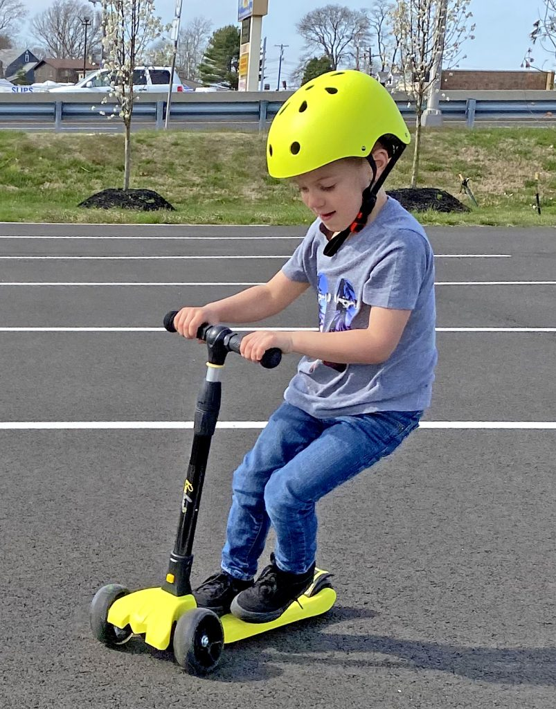 Boy riding BeeFree scooter