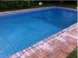 Blue safety net on inground pool