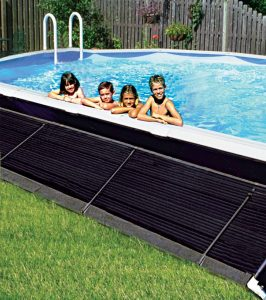 Kids in aboveground swimming pool next to solar panels