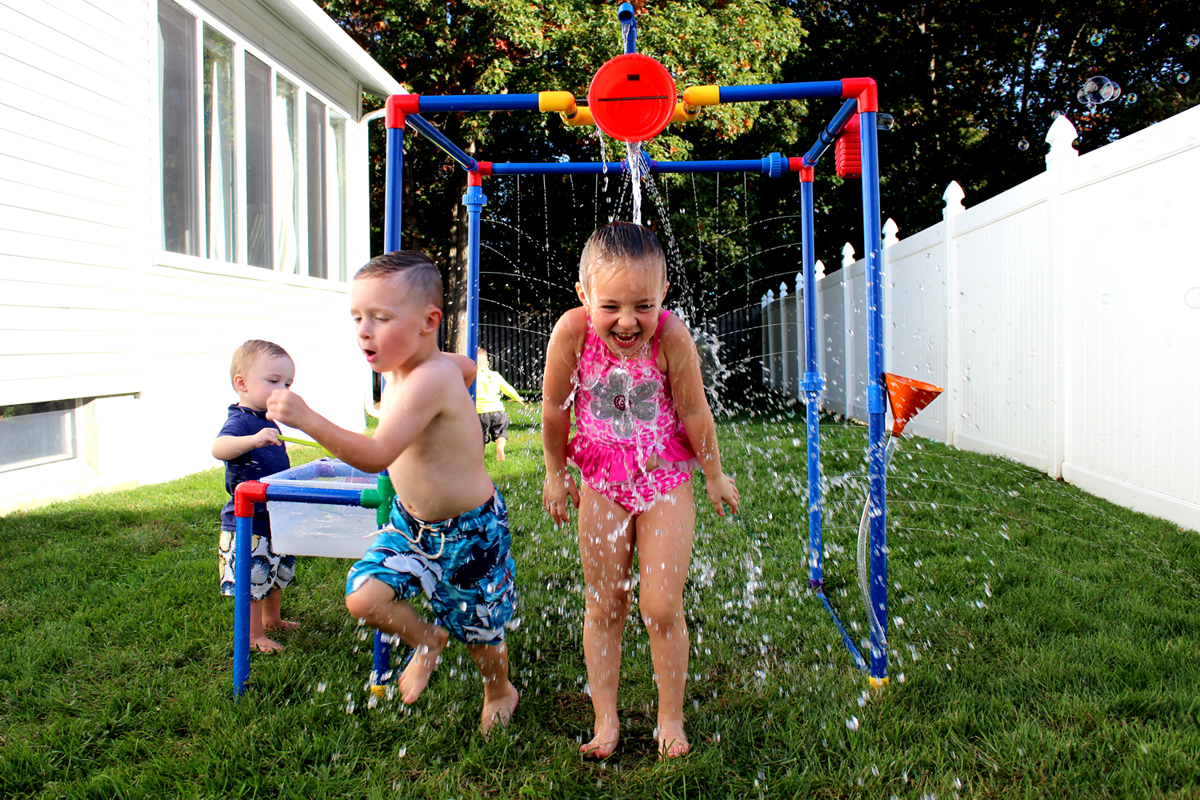 Kids playing with backyard waterpark