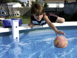 Child trying to remove ball from aboveground swimming pool